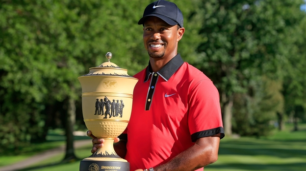 Tiger Woods holds the Gary Player Cup trophy after the Final Round of the World Golf Championships-Bridgestone Invitational in Akron, Ohio. Woods won the tournament with a score of -15.