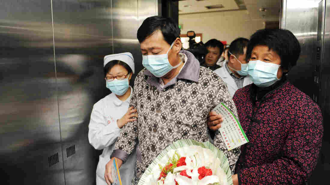 A man who just recovered from the H7N9 bird flu leaves a hospital in Bozhou, China, in April. Since early May, the number of new H7N9 cases has dramatically declined.