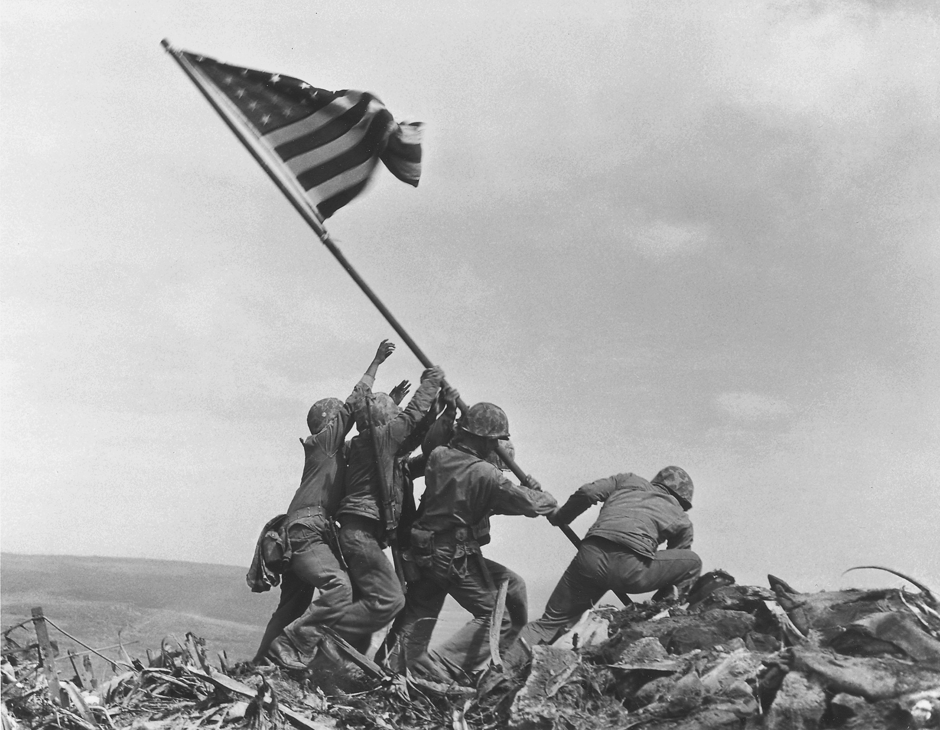 U.S. Marines of the 28th Regiment, 5th Division, raise the American flag atop Mount Suribachi, Iwo Jima, on Feb. 23, 1945.