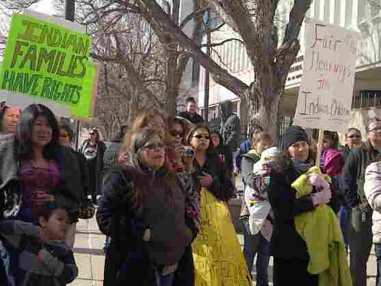 People gather outside the Rapid City, S.D. federal courthouse in March to demonstrate their support of the lawsuit filed by the ACLU on behalf of three Native mothers and the Rosebud and Oglala Sioux tribes.