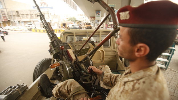 An army trooper sits beside a machine gun that is mounted on a patrol vehicle at a checkpoint in Sanaa, Yemen. Security is tight in the capital amid warnings about possible terrorist attacks. (Reuters /Landov)