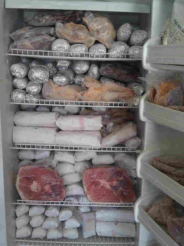 Time for a meat locker? One Flickr user's freezer after purchasing a large share of a pig.