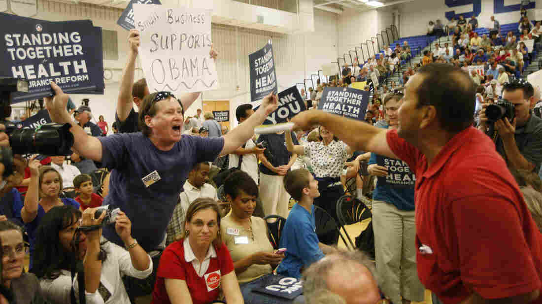 Members of the audience argue before a town hall forum on the health care overhaul hosted by Rep. Jim Moran, D-Va., and former Democratic National Committee Chairman Howard Dean, in Reston, Va., on Aug. 25, 2009.