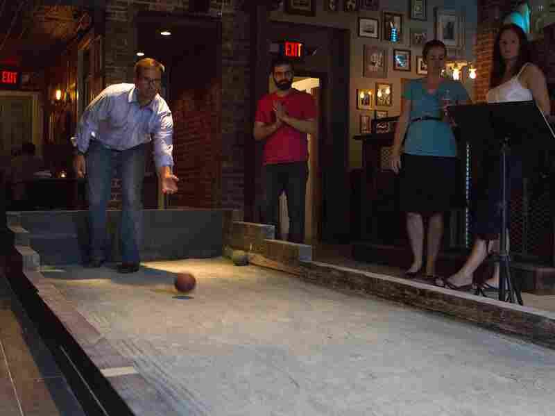 Patrons of Vendetta play bocce as part of DC Bocce League.