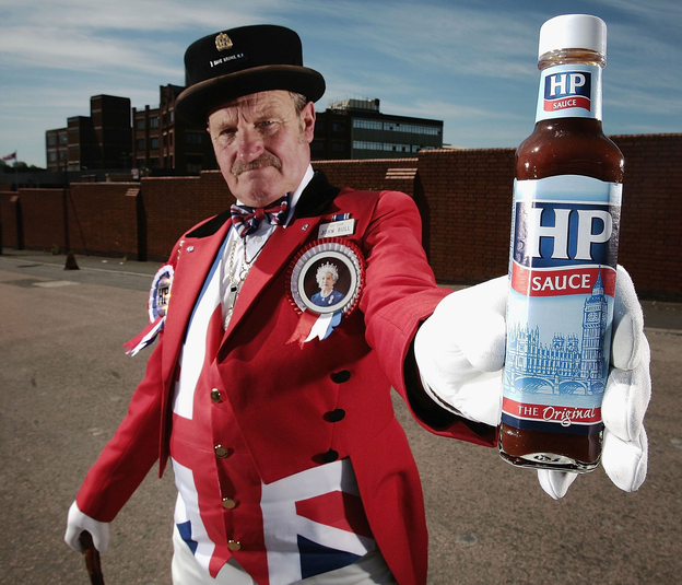 John Bull alias Ray Egan poses with a bottle of HP sauce as workers from Birmingham's HP Sauce company protest outside the factory against closure on June 3, 2006, in Birmingham, England. The HP Foods factory in Birmingham is to close and production of its famous sauce moved to Holland. HP which stands for Houses of Parliament is an iconic British brand.