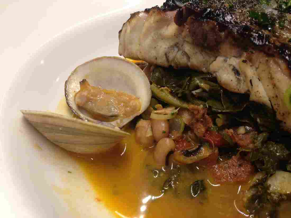 Instead of throwing out the nutritious broth that's left over when you cook down greens, why not use it as the base for a delicious dish like this rockfish with clams in a garlic-shallot pot liquor sauce?