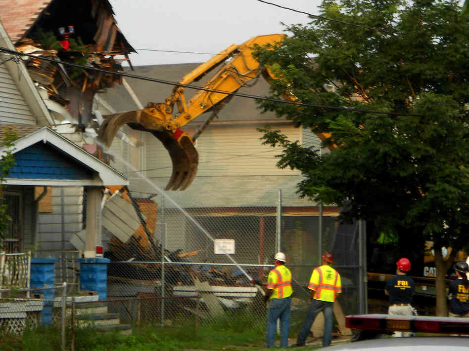 The house of Ariel Castro, which was found to have served as a prison for three women for years, was reduced to rubble Wednesday.