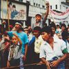 Demonstrators march on a street in downtown Rangoon in August 1988. Students, civil servants, monks and others joined the protests that summer.