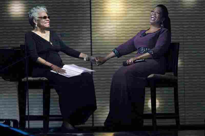"""Angelou (left) and Oprah Winfrey laugh during a star-studded taping of """"Surprise Oprah! A Farewell Spectacular"""" on May 17, 2011, in Chicago."""