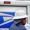 U.S. Postal Service letter carrier Jamesa Euler delivers mail in the rain in Atlanta in February.