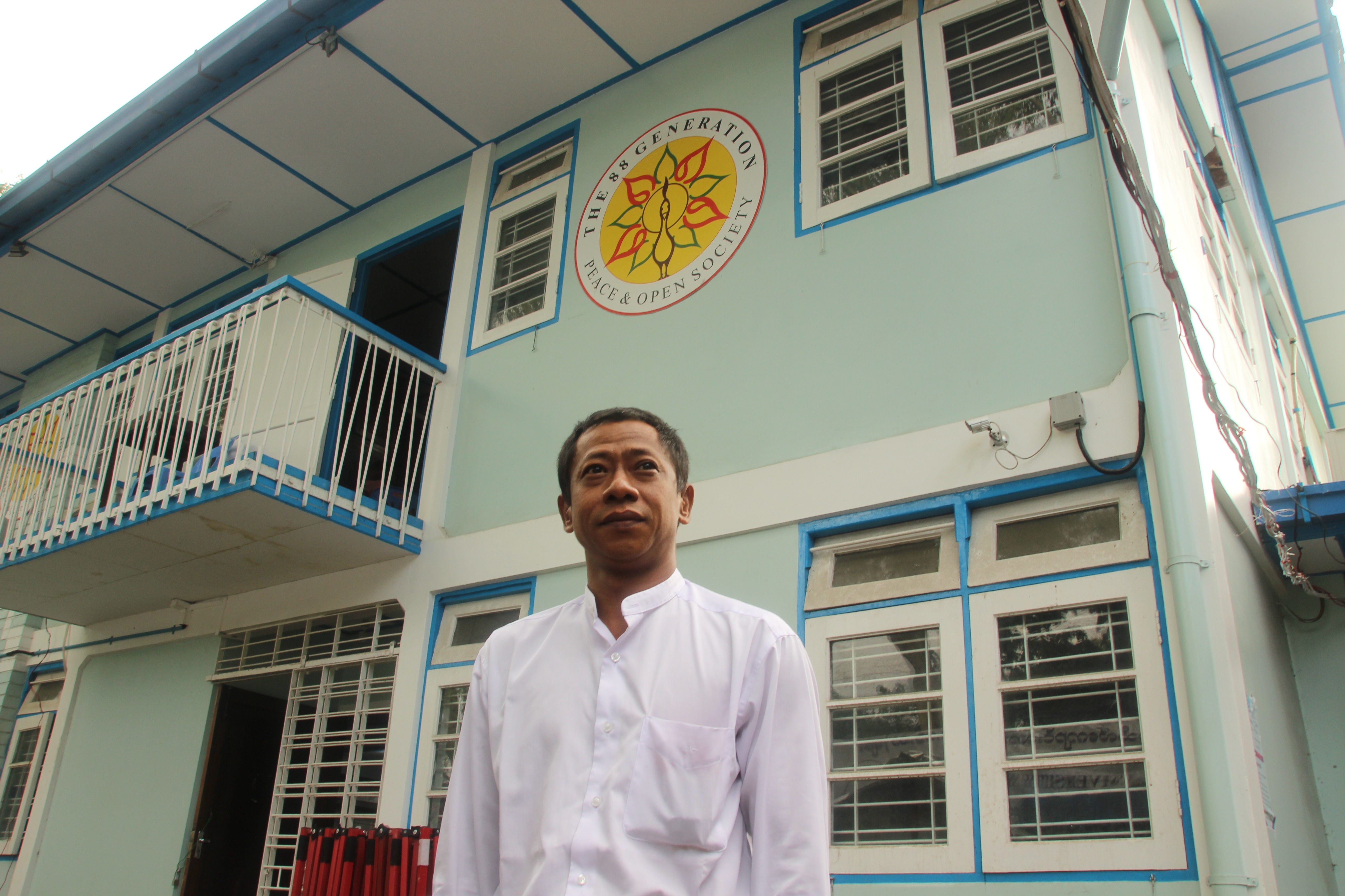 "Htay Kywe, a student leader of the protests in 1988, stands outside the 88 Generation Students Group offices in Yangon this year. When the protests began, he says, ""we students had no hopes for any jobs after school. We were totally lost."""