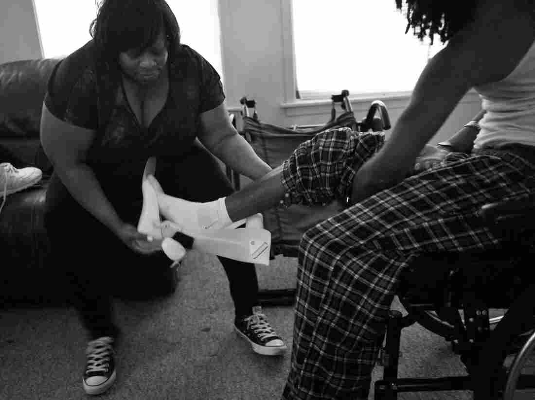 Ondelee Perteet and his mother, Detreena, at their home in Chicago. In 2009, then-14-year-old Ondelee was shot in the jaw at a birthday party on Chicago's West Side. The bullet severed his spine, paralyzing him from the neck down. His doctors told him that he would never walk again, but three years later, he is walking with the help of crutches.