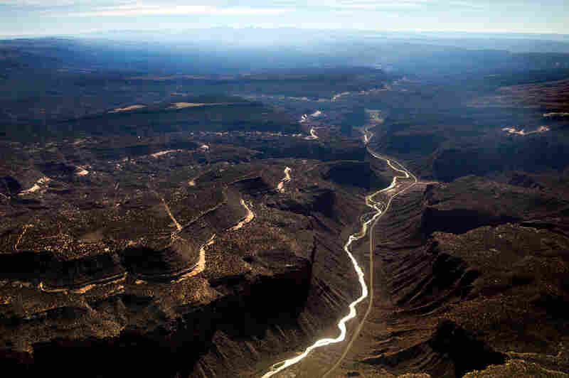 """A major tributary of the Colorado River, the Dolores River Basin, is seen south of Grand Junction, Colo. Ken Neubecker, executive director of the Western Rivers Institute, talks about the connection of water and energy. """"Water takes a lot of energy; a huge amount of energy. People don't realize it. We tend to take water for granted."""""""