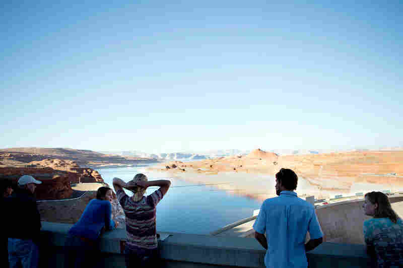 Students with Eco-Flight look over Lake Powell from the Glen Canyon Dam. Laurel Hagen, executive director of the Canyonlands Watershed Council, suggests that the answer to water preservation is a combination of endeavors, from improving technology to renewable energy such as solar panels, decreasing consumption and limiting population growth.