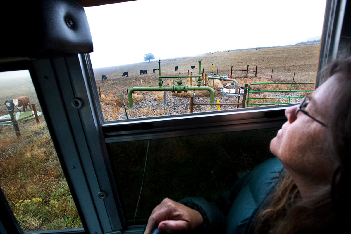 Lorie Syme looks outside at a gas pipeline valve in Battlement Mesa near Grand Junction, Colo., during a tour with Western Colorado Congress. Syme went on the tour because she wanted to learn more about the natural gas boom that has taken place in Colorado and across the country in recent years.