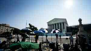 Members of the media camp outside the U.S. Supreme Court in June.