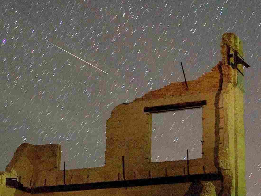 A Perseid meteor streaks across the sky early on August 13, 2007 in the ghost town of Rhyolite, Nevada.