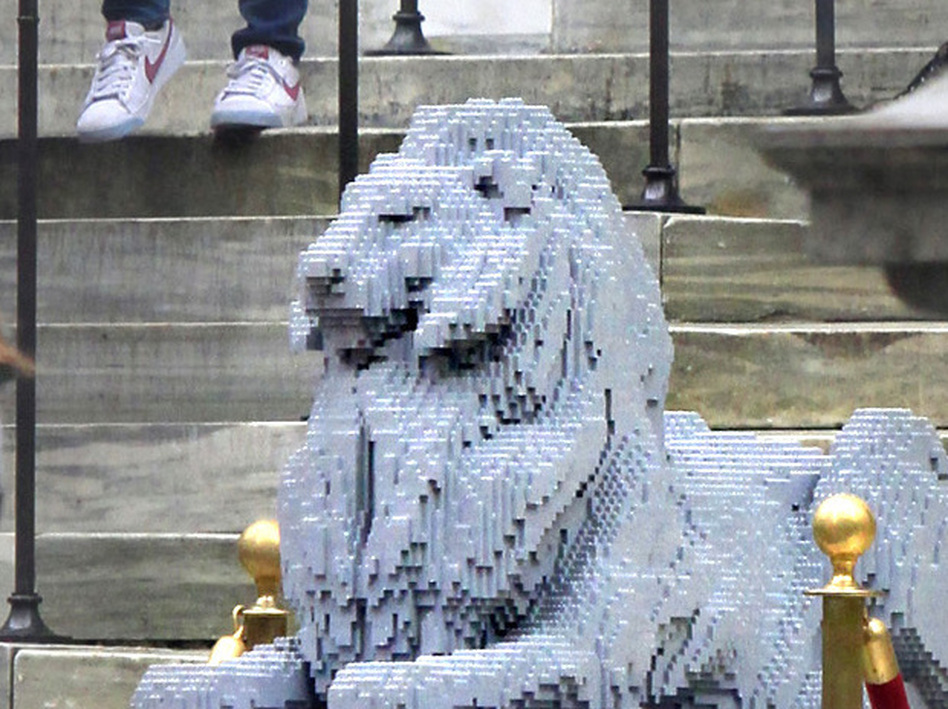 If a LEGO lion can take pride of place at the New York Public Library, why not video games in the reading rooms? The NYPLarcade program is a kind of book club for gamers, inviting participants to dive deep with discussions of strategy, game structure and more. (Bebeto Matthews/AP)