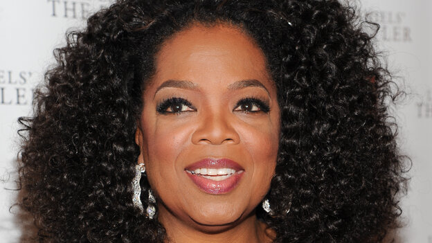 Media mogul and actress Oprah Winfrey attends a special screening of The Butler in New York City on July 31. She recently had an encounter with a saleswoman in Switzerland over a Tom Ford handbag.