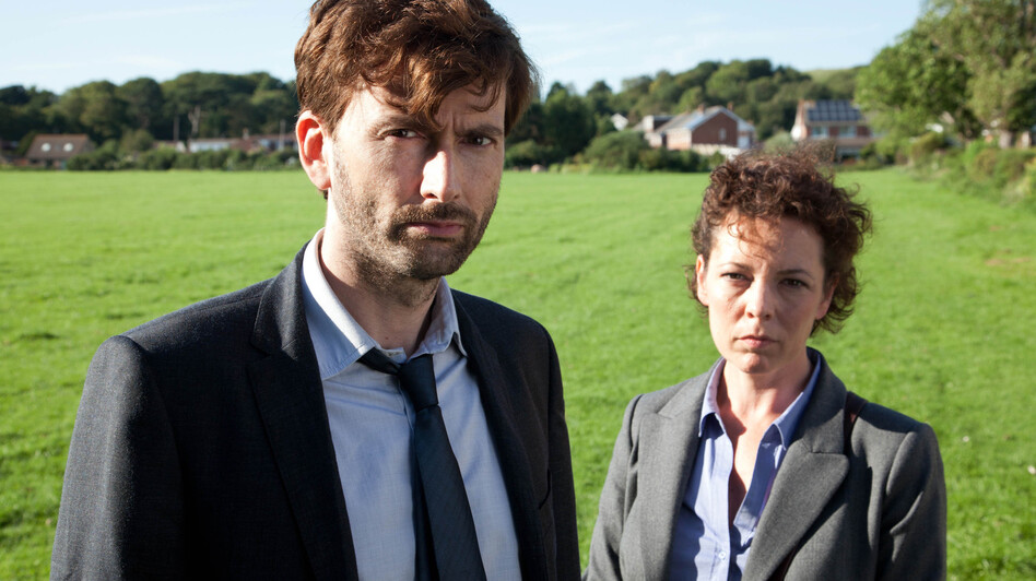 David Tennant plays Detective Inspector Alec Hardy alongside Olivia Colman as Detective Sergeant Ellie Miller, investigating the murder of a young boy in the BBC crime drama Broadchurch. (BBC)