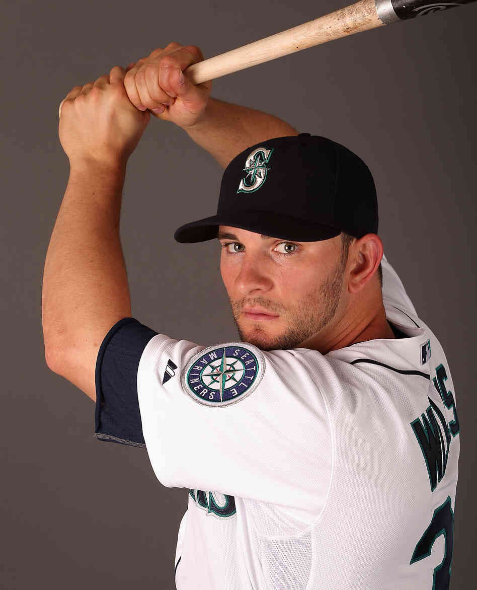 Have bat, will travel: Casper Wells just before the start of the season, when he was with the Seattle Mariners. Four stops later, he's landed with the Philadelphia Phillies.