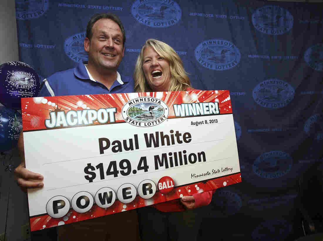 Paul White of Ham Lake, Minn., and his partner Kim VanReese. White bought one of the three winning tickets in Wednesday's $448.4 million Powerball lottery. While one-third of the jackpot is about $149.4 million, he's chosen to take his share in a lump sum rather than spread out over many years. That lump sum is $86 million, which after taxes will be about $58 million.