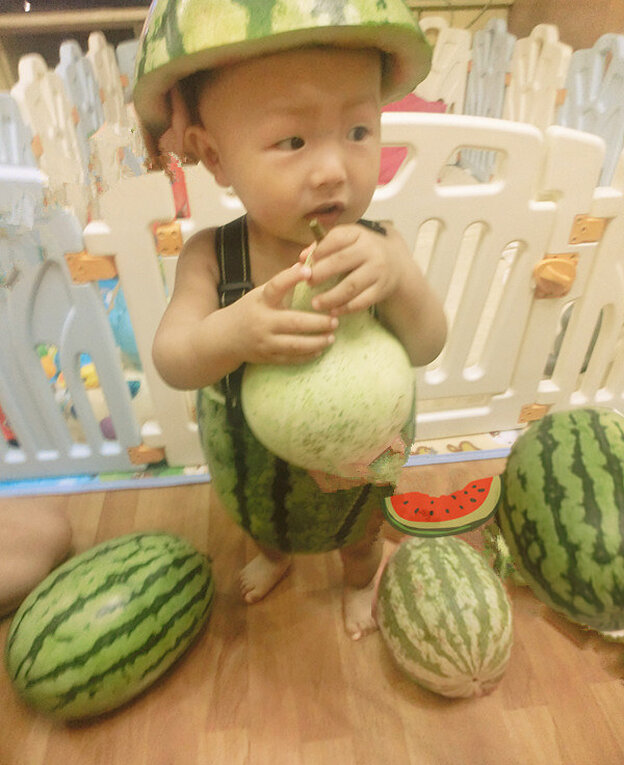 Mom, I'm not so sure about this: An example of the photos of babies dressed as watermelons being shared by Chinese Internet users.