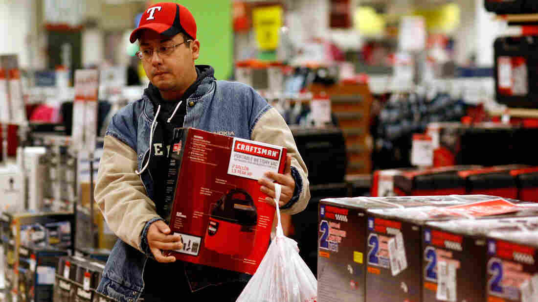 In Texas, back-to-school shoppers are being urged to boycott Macy's and Kroger stores for their efforts to quash a wage fairness bill. In this file photo, a man shops at a Sears store in Fort Worth.