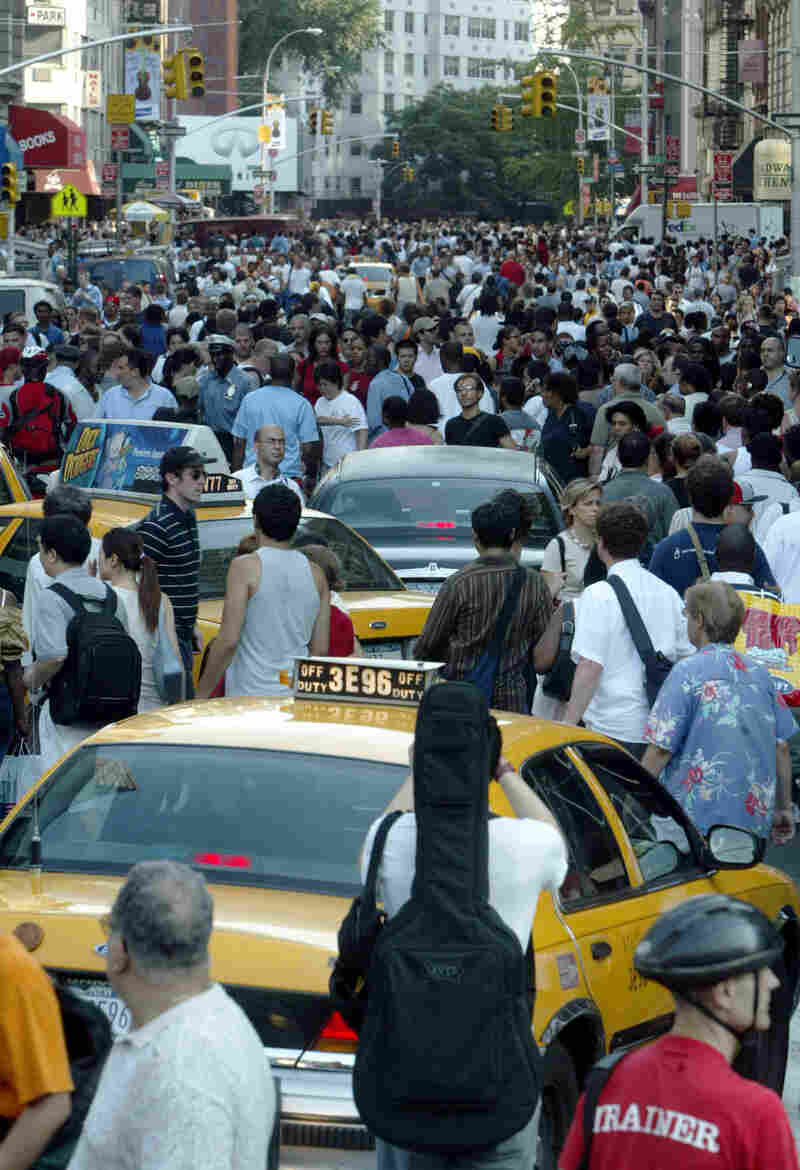 Traffic on Broadway in New York snarled with cars and pedestrians during the outage, which shut down traffic lights and subway service.