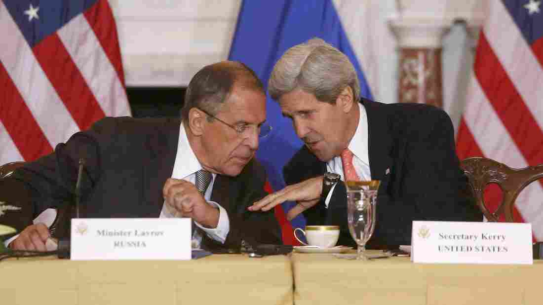 Secretary of State John Kerry talks with Russian Foreign Minister Sergei Lavrov at the State Department in Washington on Friday.
