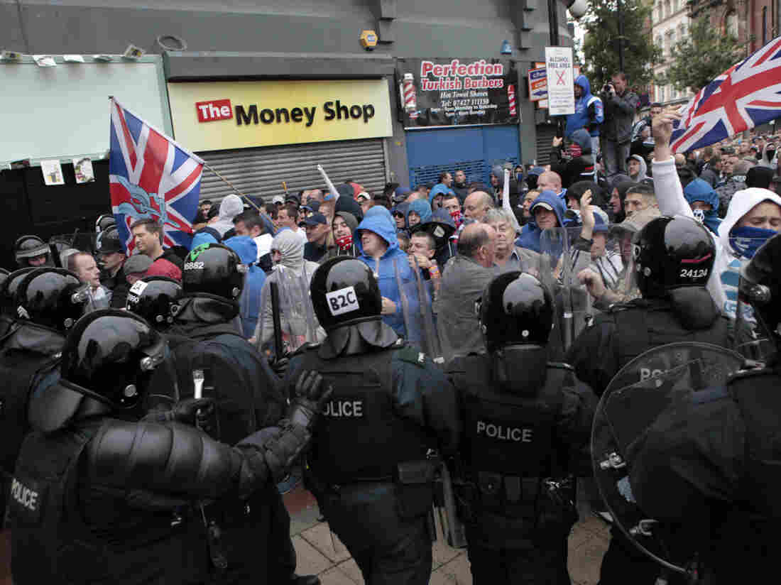 Loyalist protesters clash with riot police in the center of Belfast, Northern Ireland, on Friday.