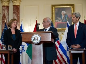 Chief Palestinian negotiator Saeb Erakat speaks to the media with Israel's chief negotiator and Justice Minister Tzipi Livni (left) and Secretary of State John Kerry in Washington on
