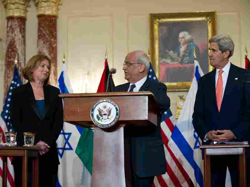 Chief Palestinian negotiator Saeb Erakat speaks to the media with Israel's chief negotiator and Justice Minister Tzipi Livni (left) and Secretary of State John Kerry in Washington on July 30.