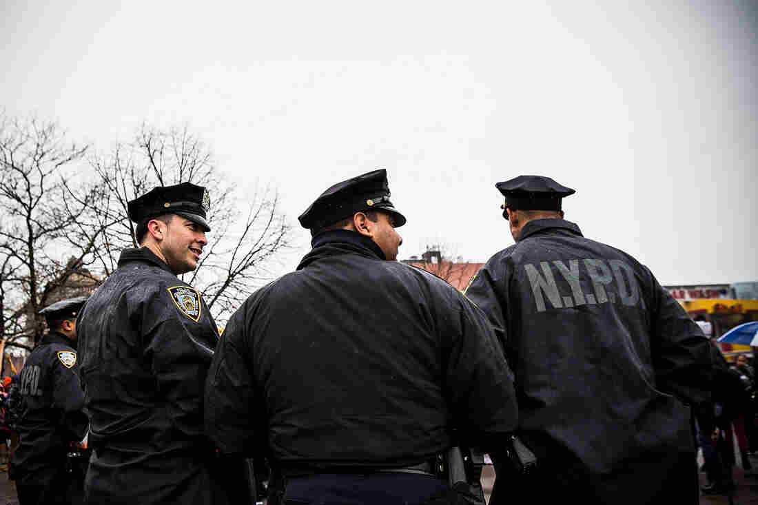 New York Police Department officers monitor a march against stop-and-frisk tactics used by police on Feb. 23 in New York City.