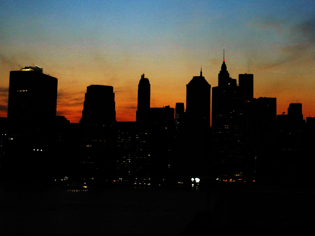The sun sets over the Manhattan skyline on Aug. 14, 2003. A major power outage doused the lights on more than 50 million people across the Northeastern U.S. and part of Canada.