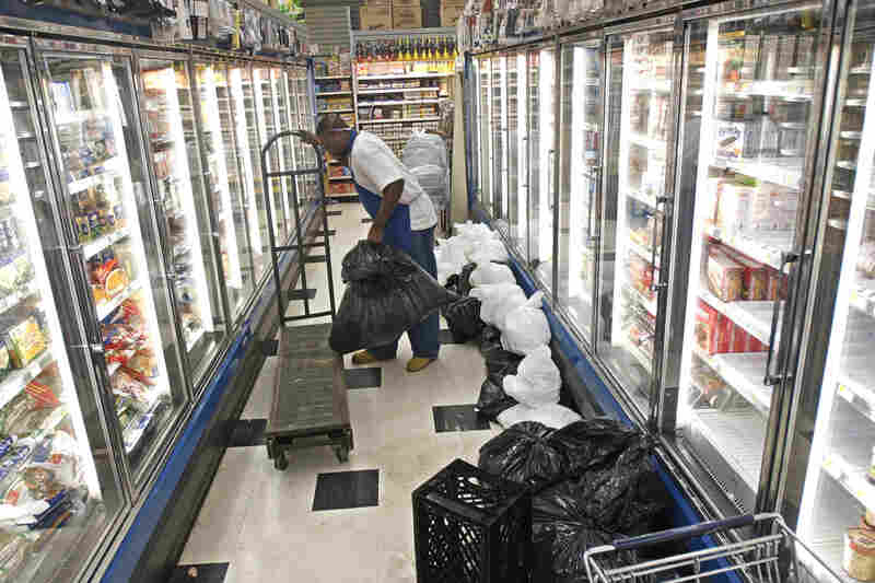 Frozen food manager Rodney Mitchell loads trash bags full of ruined food onto a cart at Gristede's Supermarket in New York's Chelsea neighborhood on Aug. 18. The blackout shut down the store's freezers and refrigerators.