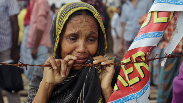 A Bangladeshi woman cries on Aug. 2 at the site of Rana Plaza building collapse near Dhaka, Bangladesh. The building came crashing down in April, the worst tragedy in the history of the global garment industry.