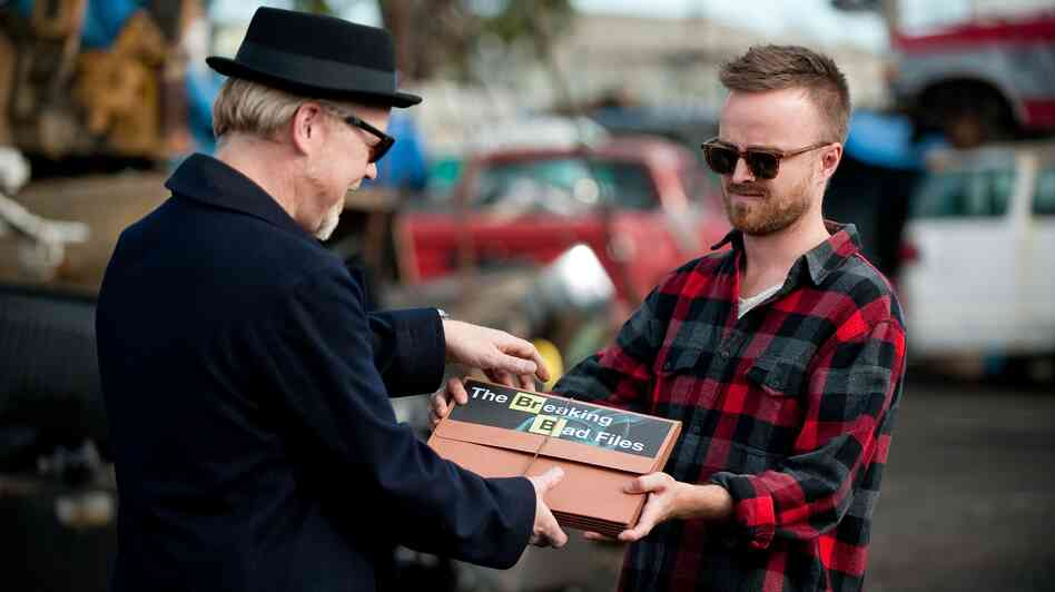 Adam Savage and Aaron Paul trade so