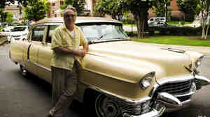 American Safari tour guide Tad Pierson stands beside his 1955 pink Cadillac. Visitors to Memphis can get a personalized tour that highlights the city's rich music heritage.