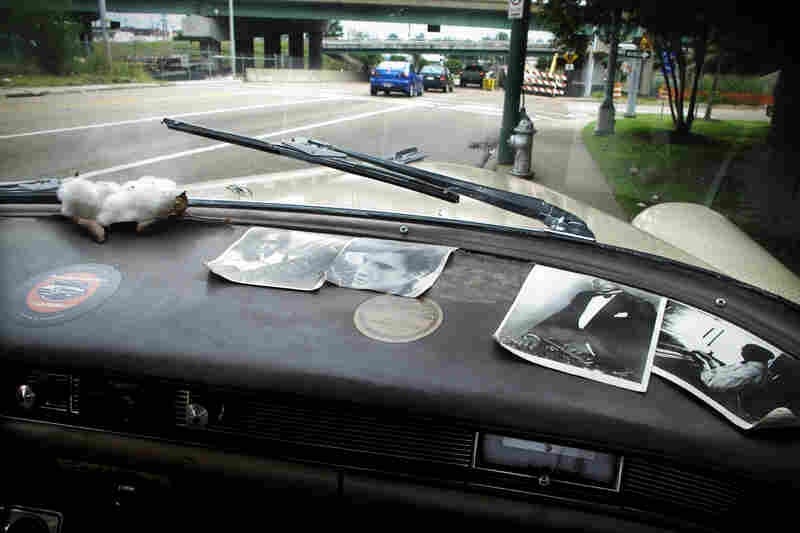 Photographs of famous Memphis musicians clutter the dash of the vintage car.