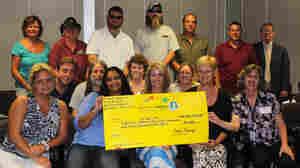 'Ocean's 16' Powerball Winners Claim Share Of Jackpot