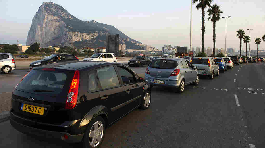 A dispute over fishing rights at Gibraltar has grown into an international spat between Britain and Spain. Here, cars sit in line at the border crossing between Spain and Gibraltar earlier this month.