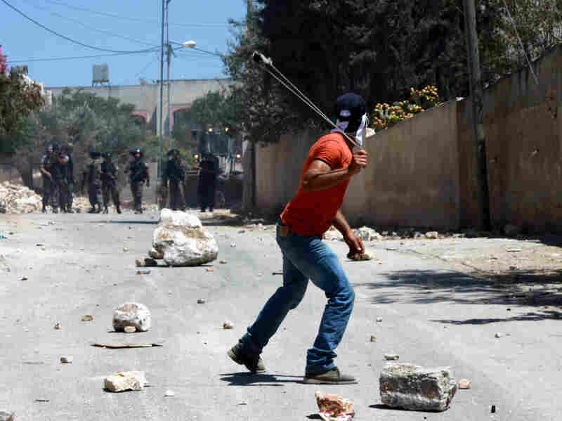 Violence has decreased in recent years, but there are still occasional clashes. Here, Palestinian protesters throw stones at Israeli soldiers on Aug. 9 near the West Bank city of Nablus.