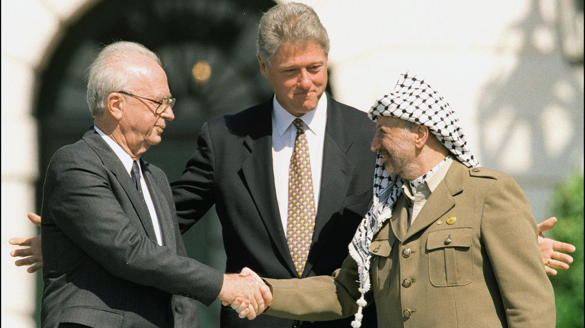 Israeli-Palestinian peace talks were launched 20 years ago when Israeli Prime Minister Yitzhak Rabin (left), Palestinian leader Yasser Arafat (right) and President Bill Clinton met at the White House on Sept. 13, 1993. But today, some of the issues appear more intractable than ever.