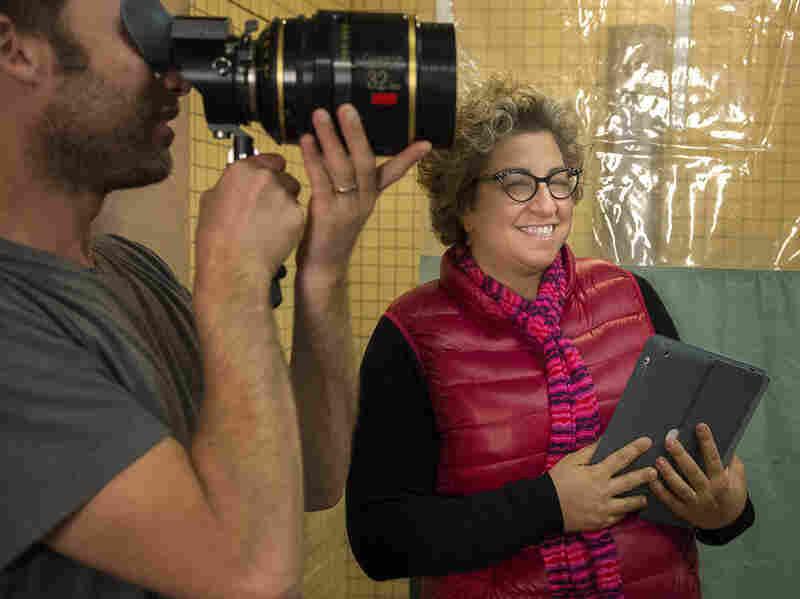 Jenji Kohan, seen here on the set of Orange Is the New Black, began her writing career on The Fresh Prince of Bel-Air.