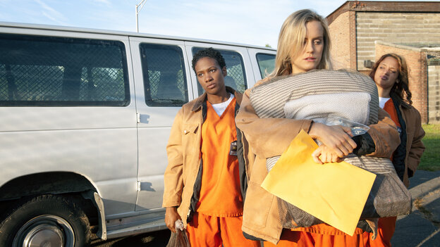 Janae Watson (Vicky Jeudy), Piper Chapman (Taylor Schilling) and Dayanara Diaz (Dascha Polanco) arrive in prison in the first episode of Orange Is the New Black.