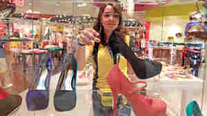 Camila DeSouza, a 17-year-old Brazilian, shops for shoes at a mall in Sunrise, Fla., on July 16, 2012. During their winter, Brazilians flock to the U.S., mainly to shop. Even with the cost of airfare figured in, many products are far cheaper in the U.S. than in Brazil.