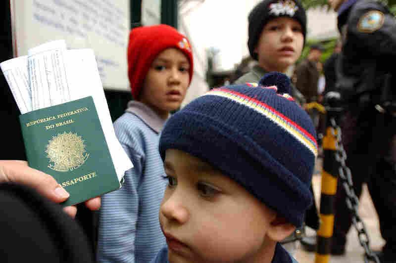 Brazilians wait outside the U.S. Consulate in Sao Paulo in 2003.