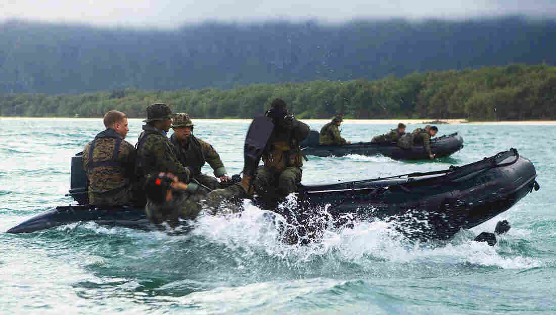 U.S. Marines with 4th Force Reconnaissance Company slide off F470 Combat Rubber Raiding Crafts during training in Waimanalo, Hawaii. The French company Zodiac has been the U.S. military's choice for inflatable rubber rafts for roughly two decades. Now the company is making the rafts in the U.S.