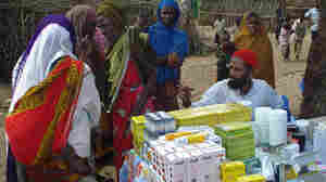 Somali women and children wait to get medicine in July 2008, from a clinic run by Doctors Without Borders about 20 miles south of Mogadishu.